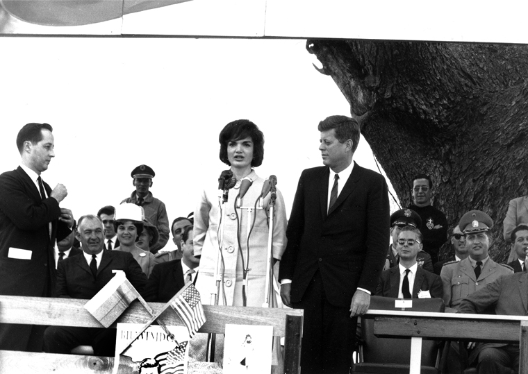 ST-285-7-61 16 December 1961 Trip to South America. First Lady addresses audience at La Morita, Venezuela. Photograph by Cecil Stoughton, White House, in the John F. Kennedy Presidential Library and Museum, Boston.